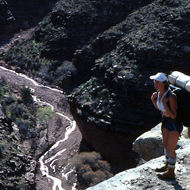 A backpacker above a creek (Hermit?).