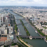 A view from the top of the Eiffel Tower south along the Seine.