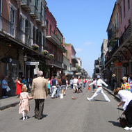 A Bourbon Street scene, with a street performer.