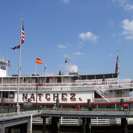 The Natchez steamboat; the person on top is playing a steam organ.