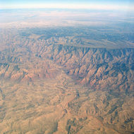 An aerial view of a mountainous desert region of the American Southwest.