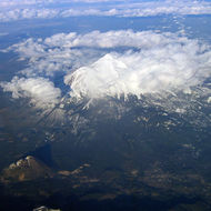An aerial view of Mount Shasta, February 2006, with Shastina and the town of Mt. Shasta below.