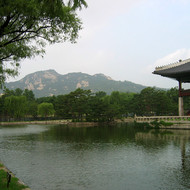 The Gyeonghoeru, a large raised pavilion overlooking an artificial lake inside the Gyeongbokgung Palace grounds.