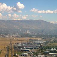 A view of Salt Lake City from a landing commercial jet.