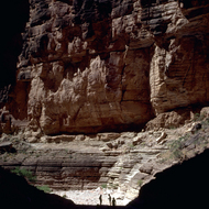 People silhouetted on a hike in a side canyon of the Colorado River.