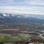 An aerial view of the Great Salt Lake marshes and Bountiful, with Salt Lake City in the distant right.