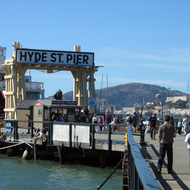 The San Francisco Maritime National Historical Park at the Hyde Street Pier, San Francisco, with Alcatraz Island in the background.