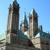 The Peace Tower (center) and part of the Centre Block of the Canadian Parliament.