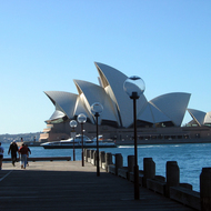 The Sydney Opera House and a ferry from the other side of Sydney Cove.