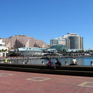 Darling Harbour, looking to the Harbourside shopping center and hotels, with the Sydney Convention Center on the left.