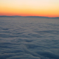 Above the clouds at sunrise.