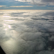 Over the Atlantic Ocean in a commercial jet.