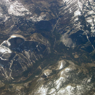 An aerial view of Yosemite Valley, including Half Dome, Glacier Point, Curry Village, and Nevada Falls.
