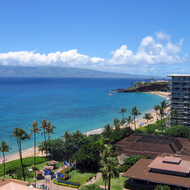 A view along Kaanapali beach from the Westin Maui to the Sheraton Maui, with Molokai in the distance.
