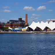 The Baltimore inner harbor with the concert pavilion and the Baltimore Public Works Museum.
