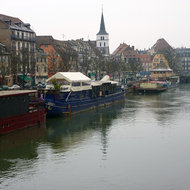 A river and docked boats in Strasbourg.