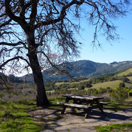 A picnic spot overlooking a high valley above Sonoma Valley at Sugarloaf Ridge State Park.