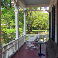 The porch of a cabin at Madewood Plantation.
