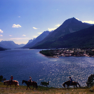 Horseback riders along Waterton Lake at Waterton Lakes National Park.