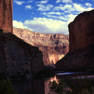 A peaceful view of a placid Colorado River in the Grand Canyon.