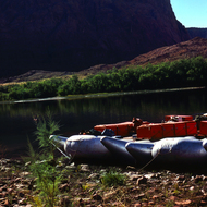 Large motor-driven rafts tied up at the Grand Canyon put-in at Lee's Ferry on the Colorado River.
