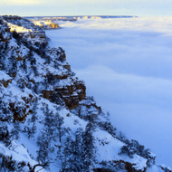 The Grand Canyon in snow and clouds.