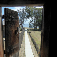 A view from one of the Fort Ross blockhouses down along the exterior wall.