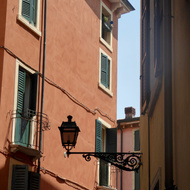 Street lamps and buildings in Verona, Italy.