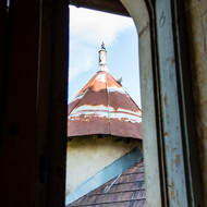 View of the tower roof through one of the Berksov palace windows.