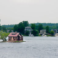 Small cottage on a very small island on the St. Lawrence river.