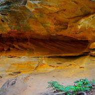 Softer sandstone eroding away.