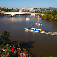City Cat commuter transport on the Brisbane River from Kangaroo Point cliffs.