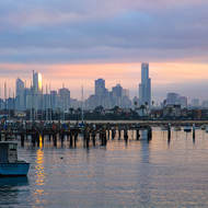 Sun rise over yachts moored at the Royal Melbourne Yacht Squadron and downtown Melbourne.