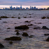 Northward view of downtown Melbourne at sunrise from the Brighton Beach foreshore reserve.