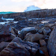 Combinations of shapes and color in a low level look at waves on rocks.
