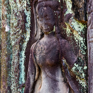 Weathered bas relief of an Apsara dancer in the western gallery of Bayon in the Angkor Thom complex.