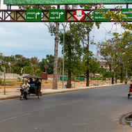 Cambodian Tuk Tuks on National Road 6; turn right to the airport and Angkor Wat.