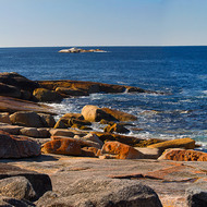 Panorama of the colored rocky shoreline near the blowhole at Bicheno.