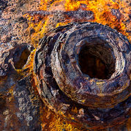 Rust textures in the shell of an old boiler.