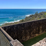 Jail wall and out to the blue pacific ocean.
