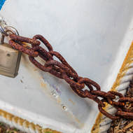 Boat chained and locked.