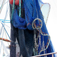Fishing nets and floats strung high.